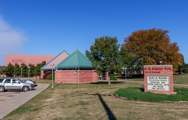 Fields Recreation Center with sign and trees